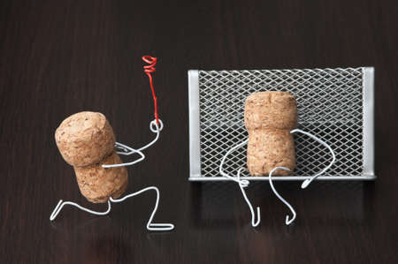 office romance,two wine corks, dating Reklamní fotografie - 9958056