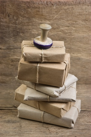 send parcel: pile parcel wrapped with brown kraft paper and tied with twine