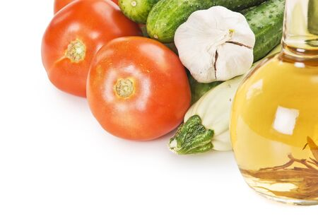 vegetables and a bottle of oil, still life  isolated on white background photo