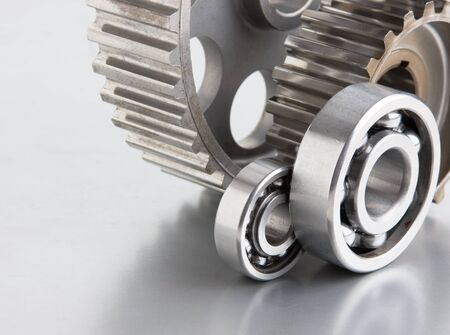 gears and bearings on a metal plate Stock Photo