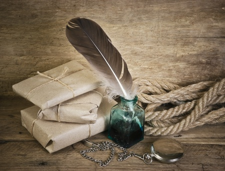 letter and a quill in the inkwell Stock Photo - 10062117