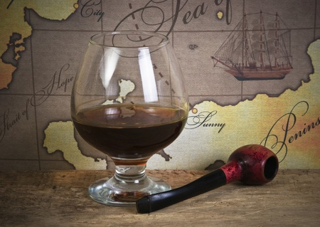 bottle and  glass of wine on background of old maps Stock Photo - 10062108