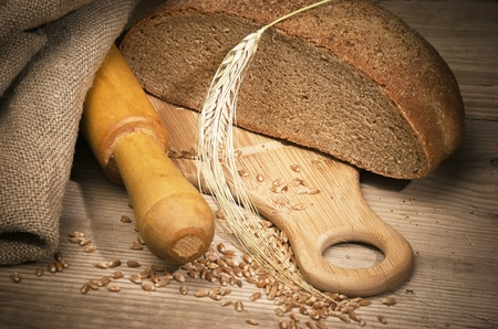 rye bread, and corn on the wooden table Stock Photo - 10320852