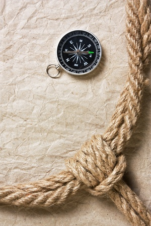 compass ,old paper and rope, still-life photo