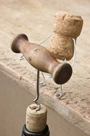 joking: wine corks and bottle with corkscrew Stock Photo