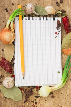notebook for recipes and spices on an old wooden table photo