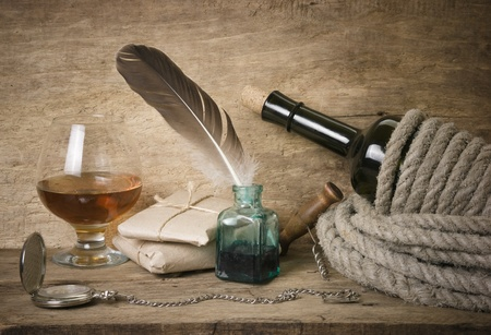 bottleneck: quill in the inkwell and glass of wine Stock Photo