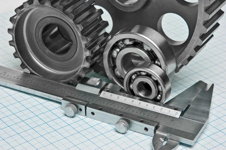 caliper with gears and bearings on graph paper Stock Photo - 10375757