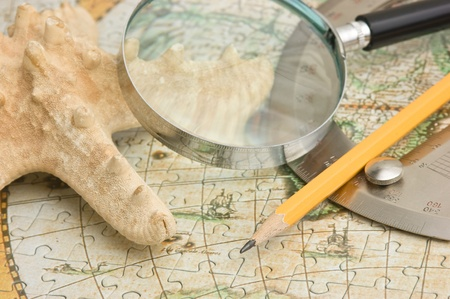 old map and starfish, still life photo