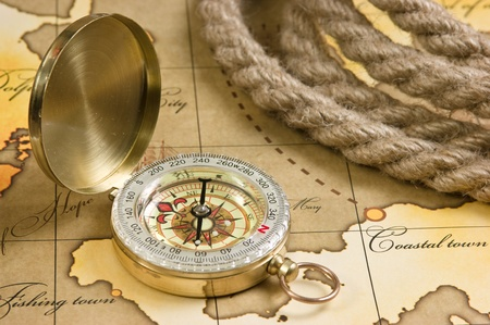 explore: compass and rope on a map Stock Photo
