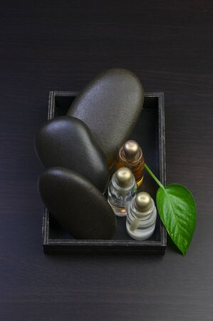 wellness environment: set of perfume oils in a wooden box