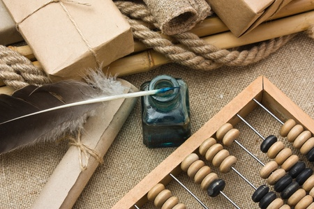pile parcel wrapped with brown kraft paper and abacus photo