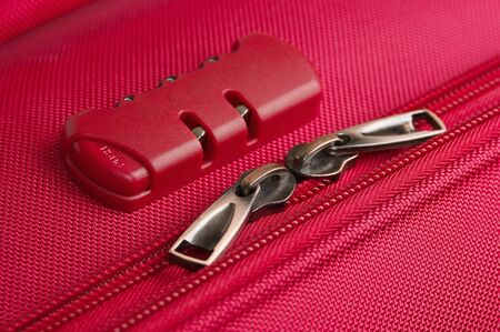 combination lock on a pink suitcase travel Stock Photo - 10654284