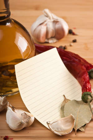 blank sheet for cooking recipes and spices on a wooden table photo