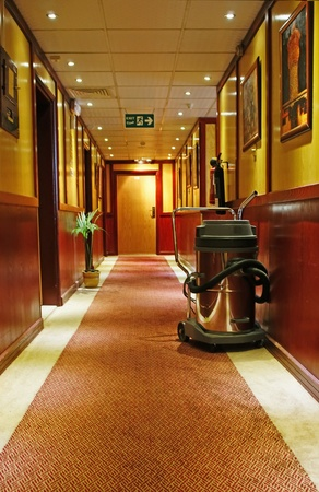 carpet clean: vacuum cleaner stands in the corridor of the Hotel  Stock Photo