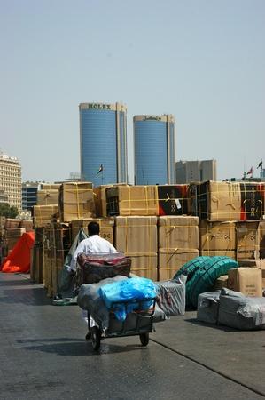 docker: DUBAI, UAE - OCTOBER 11: Docker driven cart with packs in Port Said on October 11, 2011 in Dubai, UAE.  Editorial