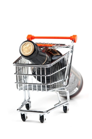 bottle of Wine in shopping cart  isolated on white background Stock Photo - 11030955