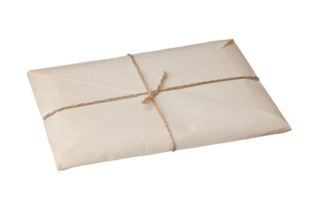 parcel wrapped with brown kraft paper isolated on white background photo