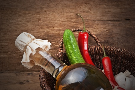vegetables and a bottle of cooking oil in a basket photo