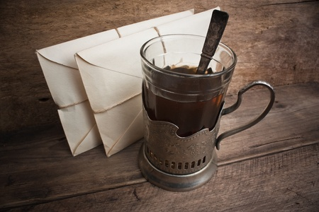 a glass of tea and letters Stock Photo - 11092251