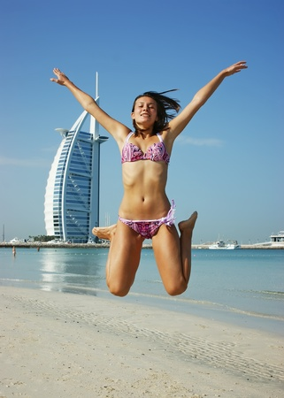 girl teenager jumps on the beach Stock Photo - 11164559