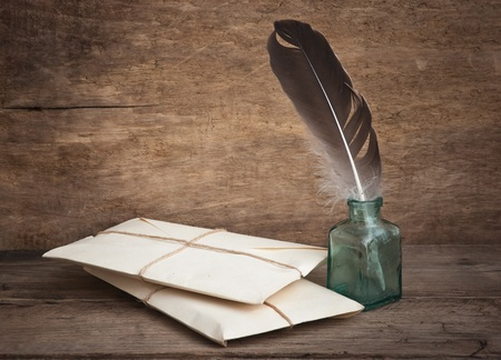 letter and a quill in the inkwell photo