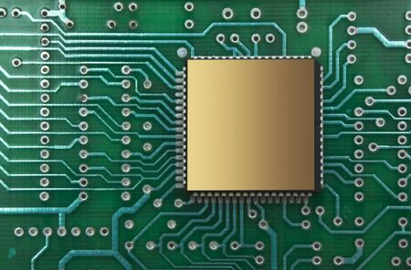 pile of microchips on a printed circuit board photo