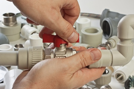 Set plumbing fittings in his hand Stock Photo