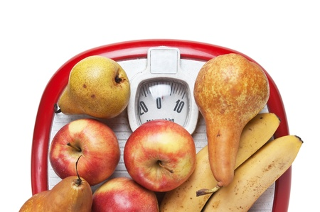 fruit on the floor scales isolated on white background photo