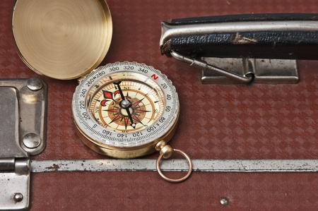old suitcase  and compass photo