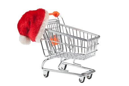 shopping cart and Santa Claus hat  isolated on white background photo