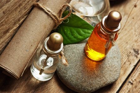 alchemy: Vials of perfume oils in old fragrance lab Stock Photo
