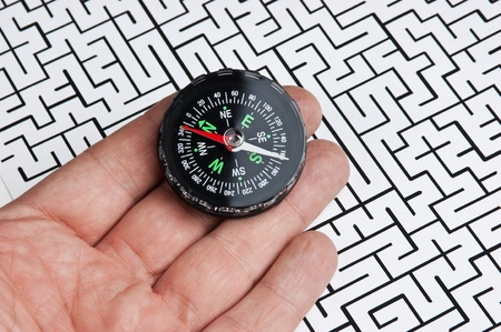 compass in hand on background of the labyrinth Stock Photo - 11840403