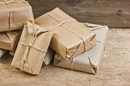pile parcel wrapped with brown kraft paper and tied with twine photo