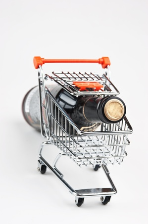 bottle of Wine in shopping cart  on white background Stock Photo - 11950736