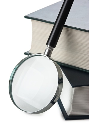 books and magnifying glass isolated on white background photo