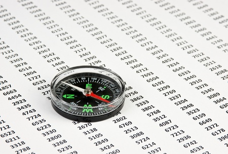 compass on a document with columns of figures Stock Photo - 11950746