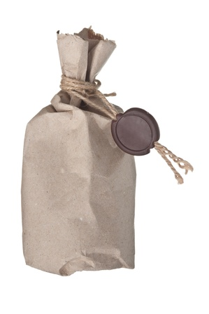 parcel wrapped with brown kraft paper with a wax seal isolated on white background photo