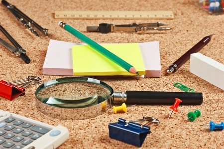 lupa: stationery in a mess on the table