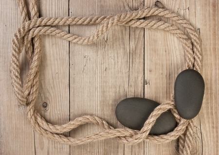 frame made of rope on a wooden background  photo