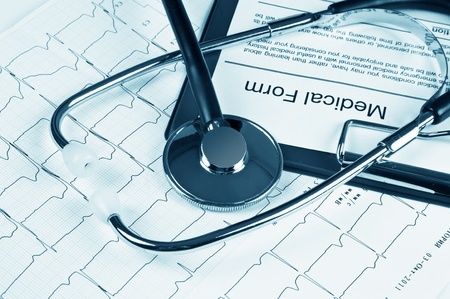 stethoscope on the chart electrocardiogram photo