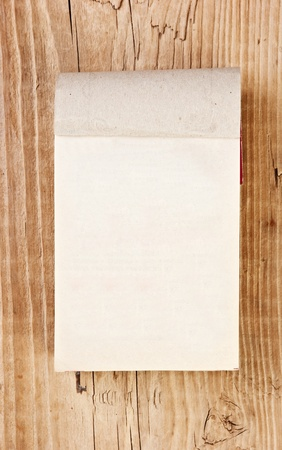 tear-off calendar on a wooden background  photo