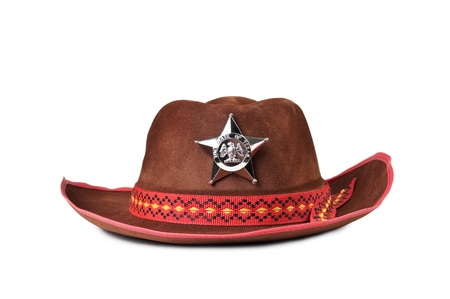 cowboy hat with the star sheriffs isolated on white background photo