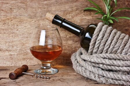 glass of wine and a bottle on the board Stock Photo - 12540303