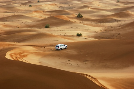 DUBAI, UAE - OCTOBER 12: Jeep safari in the sand dunes of the arabian desert in Dubai; UAE on October 12, 2011. The most favorite amusement of tourists in the Emirates. photo