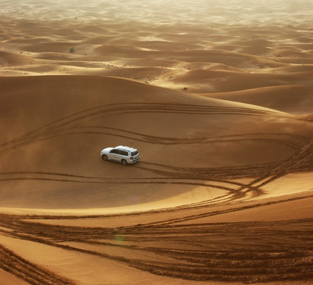 DUBAI, UAE - OCTOBER 12: Jeep safari in the sand dunes of the arabian desert in Dubai; UAE on October 12, 2011. The most favorite amusement of tourists in the Emirates. photo
