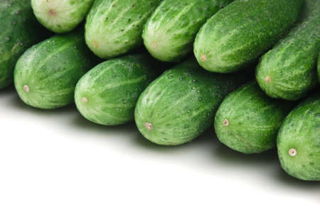 bunch of cucumbers isolated on white background photo
