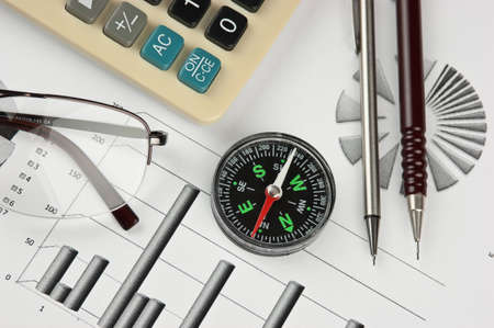 compass and working paper with  diagram photo