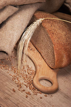 rye bread, and corn on the wooden table Stock Photo - 12950302