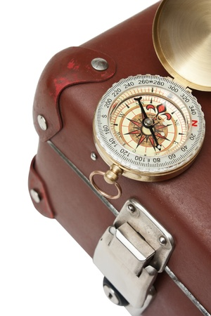 old suitcase  and compass  isolated on white background photo